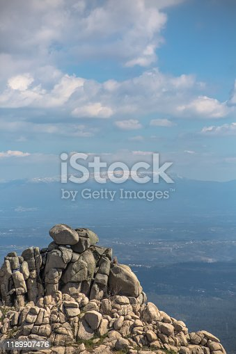 View from the top of the Caramulo mountains over the Estrela mountains, granitic rocks and undergrowth in Portugal