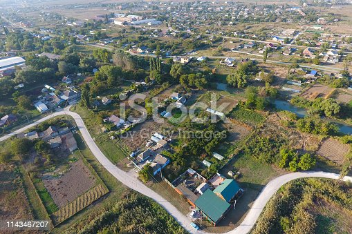 View from the top of the village. Houses and gardens. Countryside, rustic landscape. Aerial photography.