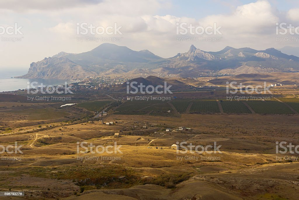View from the top on mountains and valley near coast. stock photo