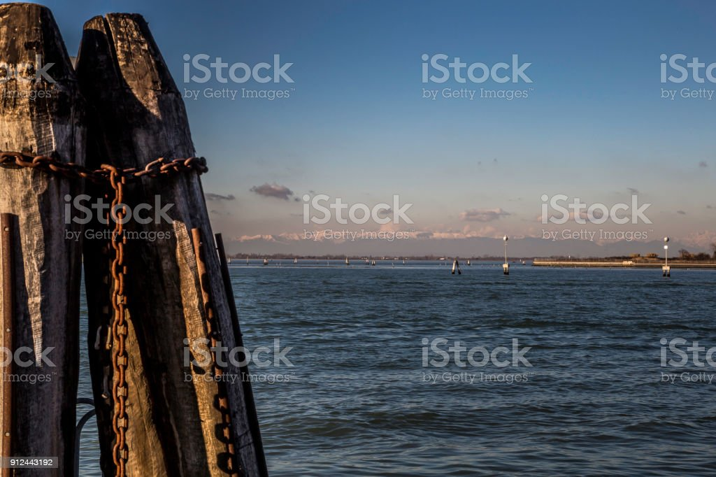 View from the Venetian lagoon to the sun-lit Alps, Italy stock photo