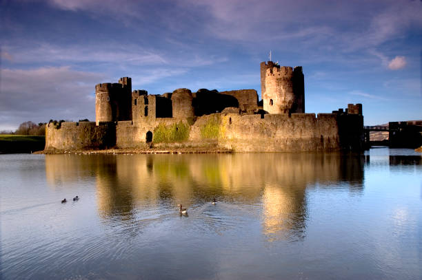 View from the water of Caerphilly Castle Caerphilly Castle, and reflection in the moat. wales stock pictures, royalty-free photos & images
