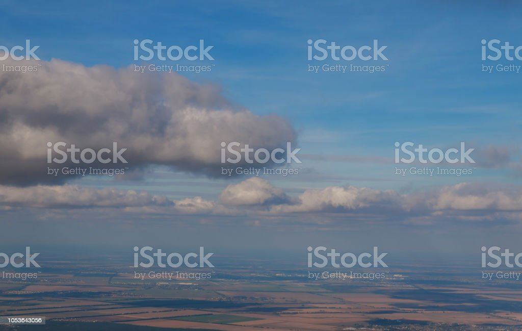 A view from the window of the plane flying at big height The airlines plane wing in the sky stock photo