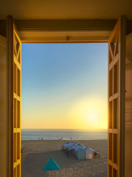 View from the window on the beach of Nazare at sunset Portugal wasser photos stock pictures, royalty-free photos & images