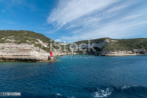 istock View from the yacht to the lighthouse, rocks. Blue sky with small clouds 1176742956