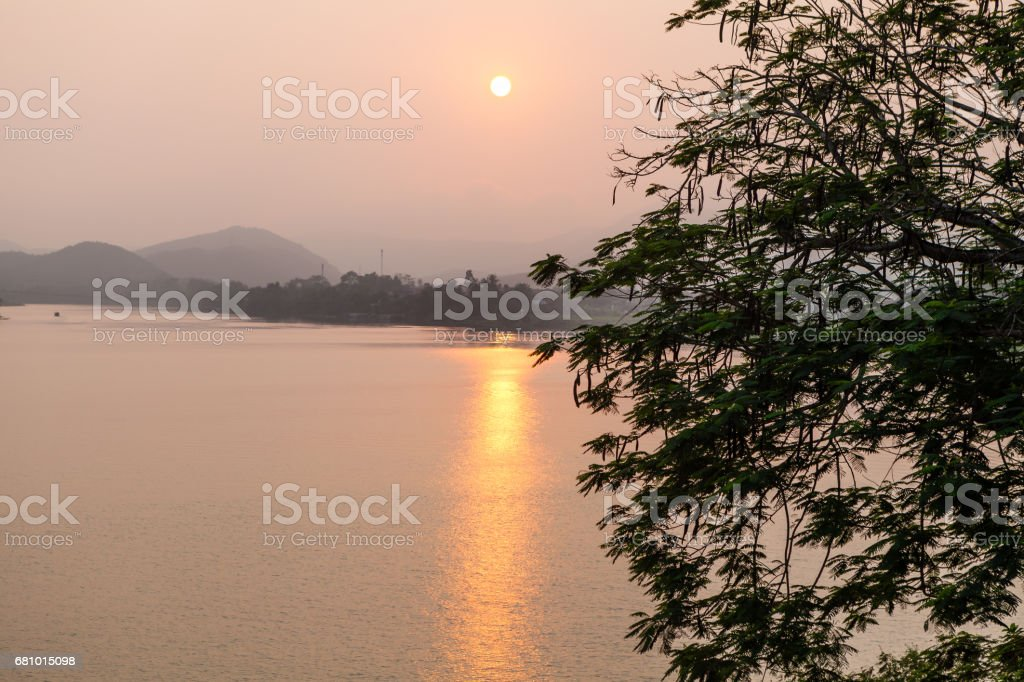 View from Thien Mu Pagoda to the sunset over Perfume River stock photo