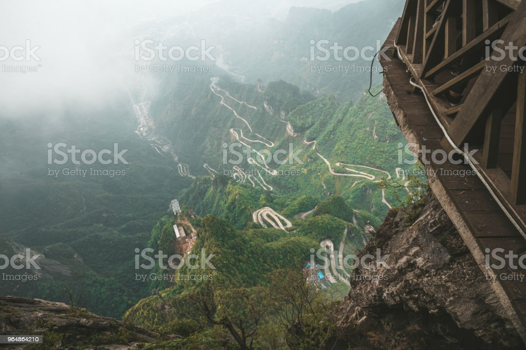 view from Tianmen mountain to the valley with mountain roads royalty-free stock photo