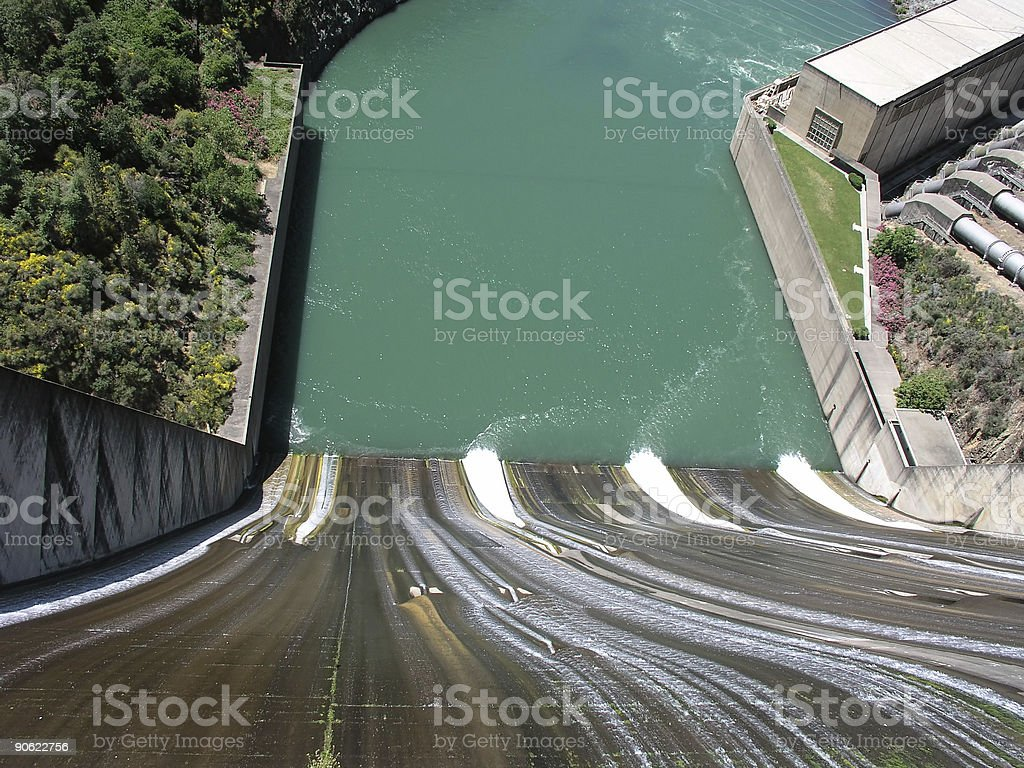 View from top of dam spillway looking down at water stock photo