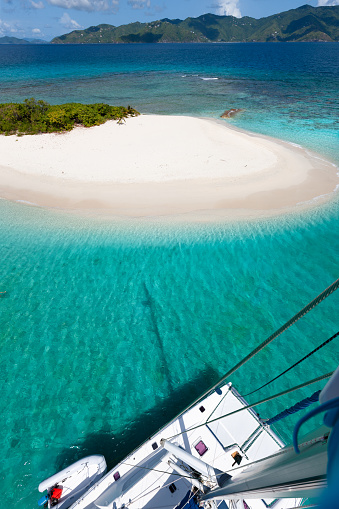 View from top of the mast of Catamaran looking down to deserted island, Sandy Spit, British Virgin Islands