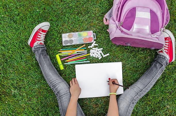 view from up on school supplies - rotes oberteil stock-fotos und bilder