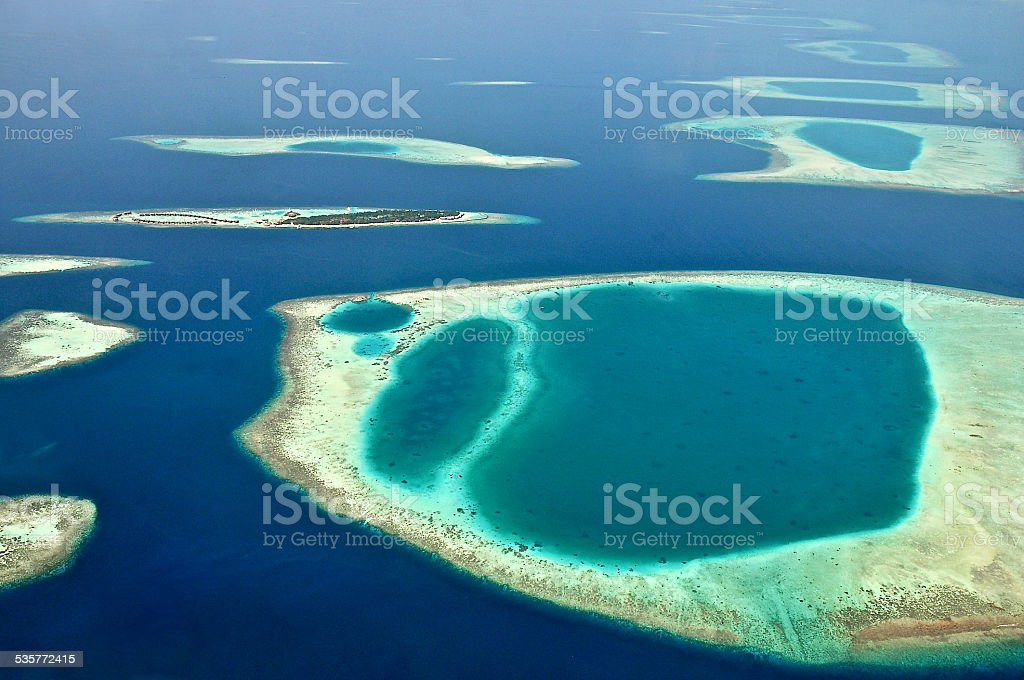 View from waterplane at Maldive island and atoll reef formations stock photo
