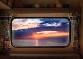 View from window camper of stunning dusk over calm ocean