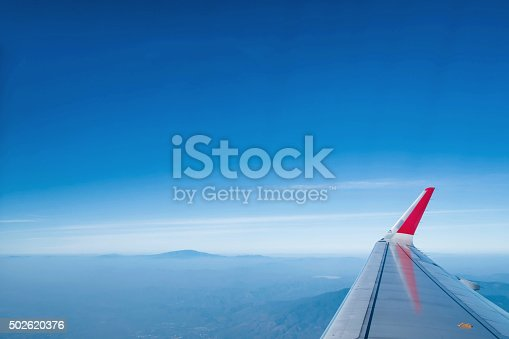 istock View from window in airplane on the sky 502620376