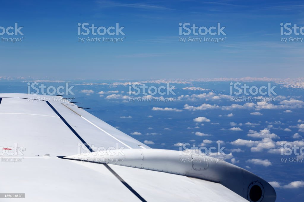 View from window of a jet plane wing royalty-free stock photo