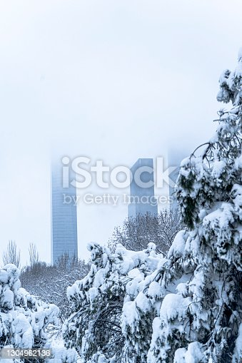 istock A view in winter of the Madrid four towers, snow city. 1304962136