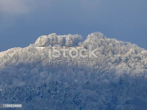 istock view in winter to the emperor hill Hohenstaufen with snow and sun in Germany 1295639995