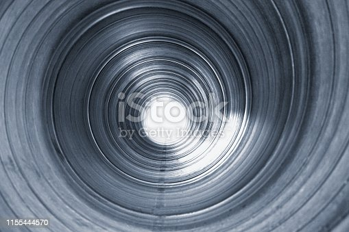 view inside large metal pipe