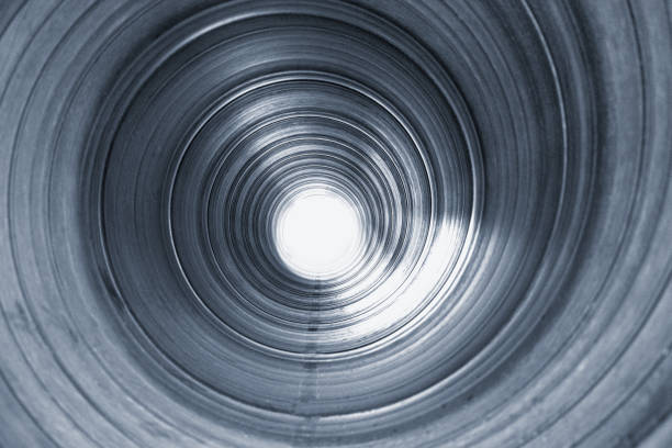 view inside large metal pipe stock photo