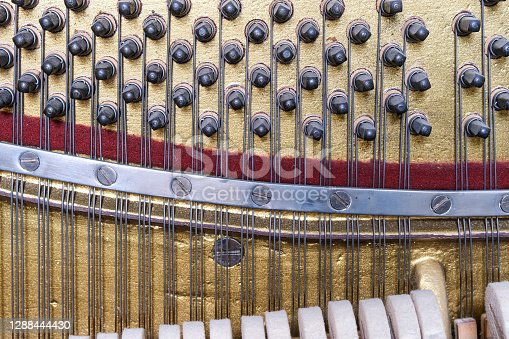 View inside of an old piano, repair and tuning of keyboard musical instruments.