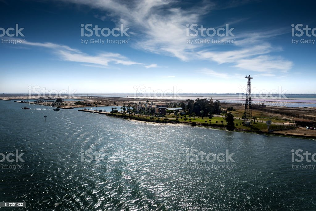 View into the entrance to the Suez Canal from the Mediterranean Sea at Port Said and Port Fouad stock photo