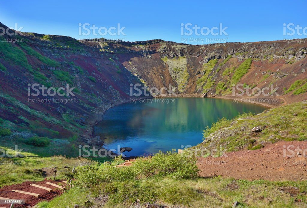 View into the Kerid crater with its blue lake at the bottom as a part of the famous Golden Circle in western Iceland stock photo