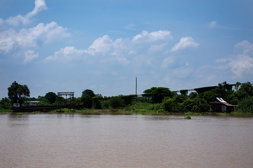 View landscape and chao phraya river with old house and antique retro vintage home at riverside Pathumthani city and movement water while high north water and flood in Pathum Thani, Thailand