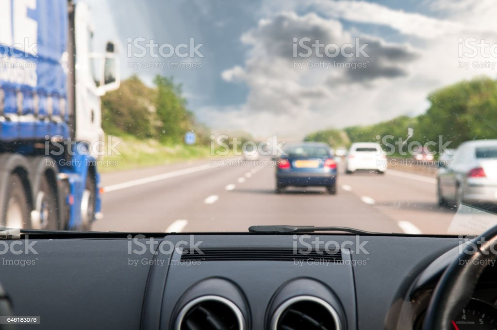 View looking out from a car windscreen driving on the road stock photo