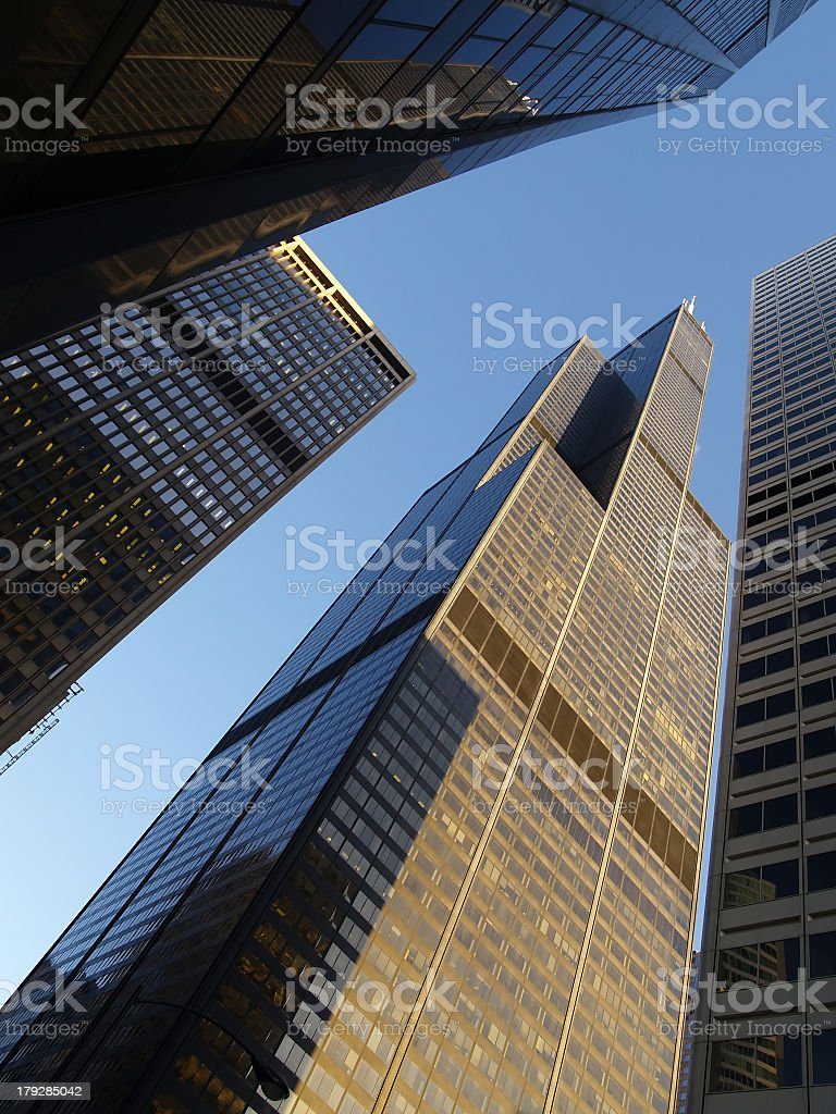 A view looking up at a tall sky scraper stock photo