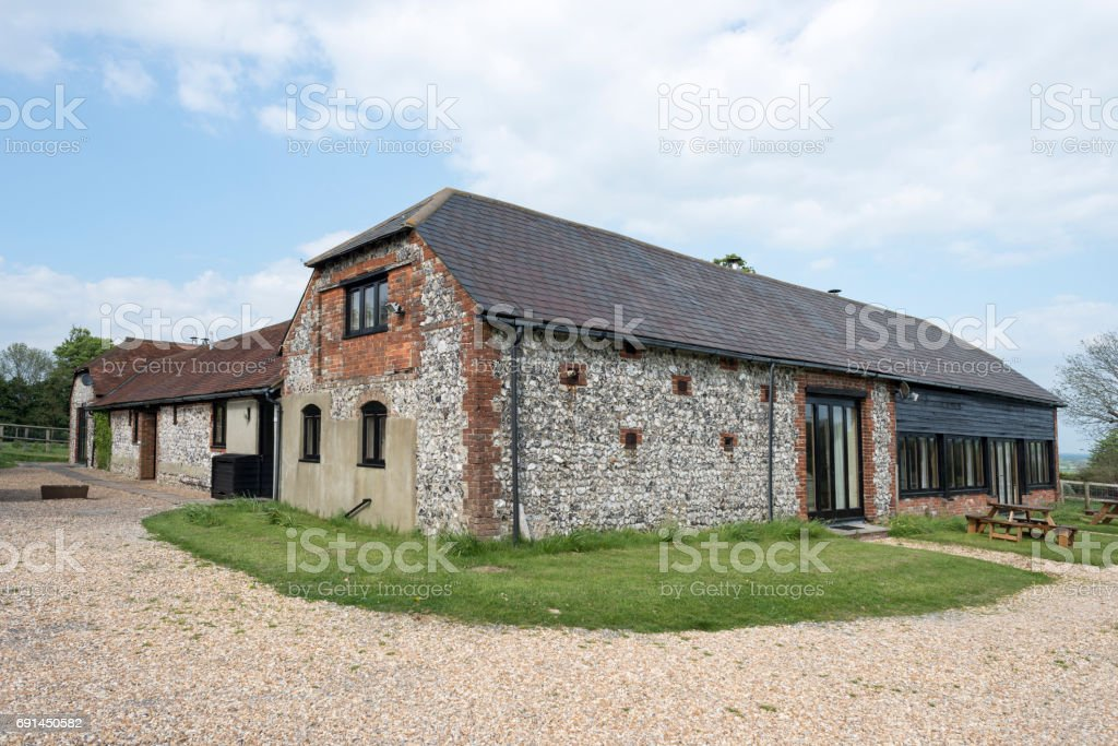 View of a Barn Cottage Exterior in Daylight stock photo