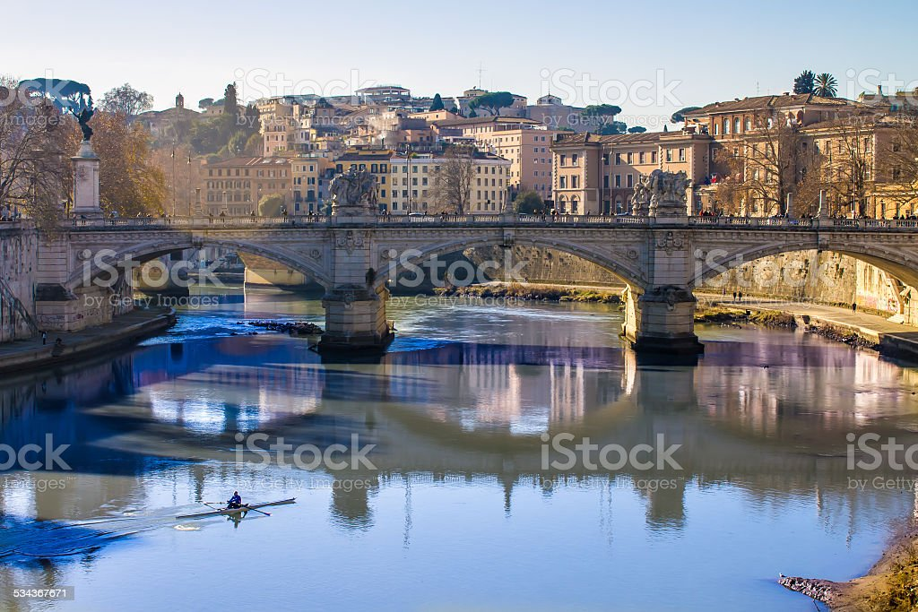 view of a bridge over the Tiber in Rome stock photo