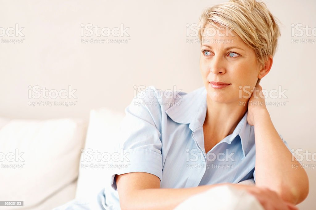 View of a contemplative mid aged lady at home royalty-free stock photo