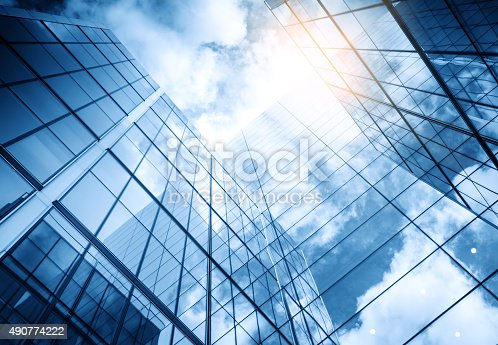 istock view of a contemporary glass skyscraper reflecting the blue sky 490774222