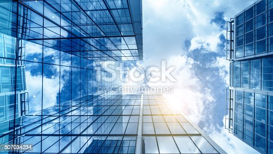 istock view of a contemporary glass skyscraper reflecting the blue sky 507034234