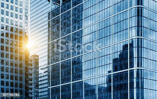 istock view of a contemporary glass skyscraper reflecting the blue sky 507754784