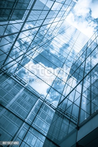 490774222istockphoto view of a contemporary glass skyscraper reflecting the blue sky 851907480