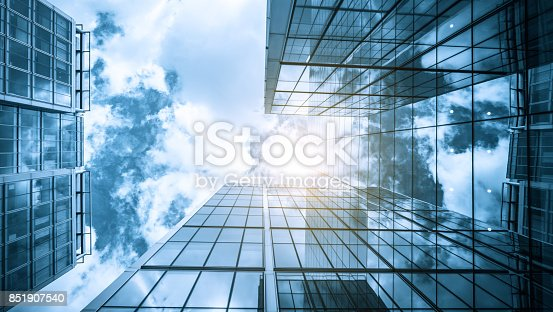 490774222istockphoto view of a contemporary glass skyscraper reflecting the blue sky 851907540