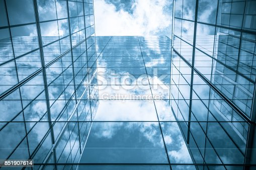 490774222istockphoto view of a contemporary glass skyscraper reflecting the blue sky 851907614