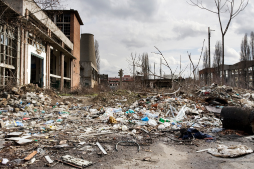 Garbage inside a destroyed factory courtyard on crisis time
