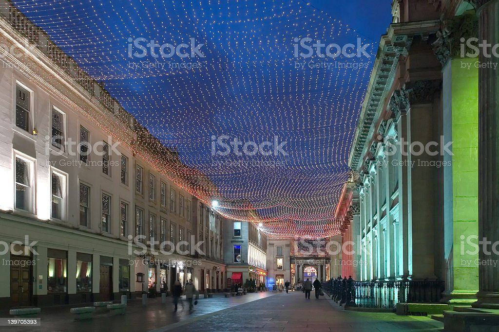 View of a downtown street showcasing city lights stock photo