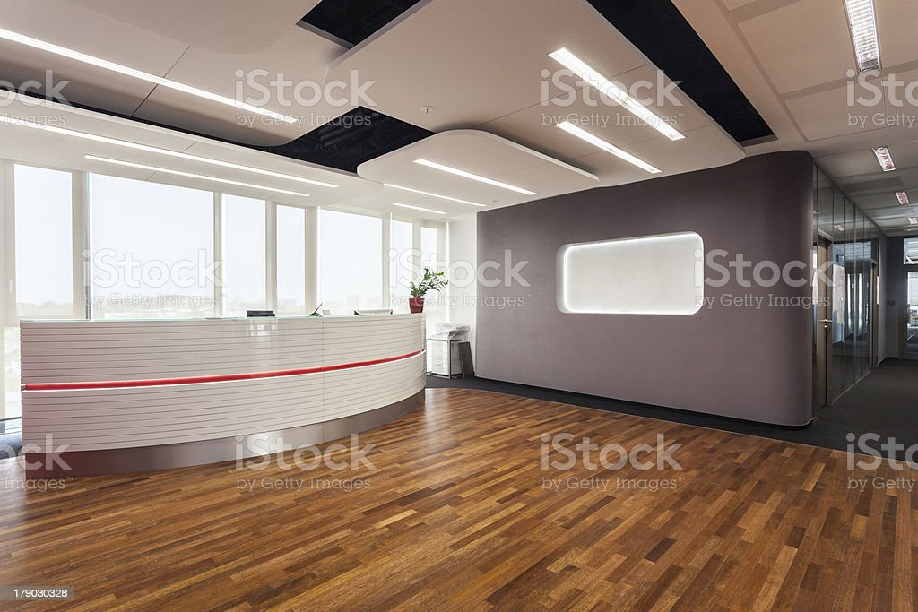 View of a empty reception room with a wooden floor stock photo