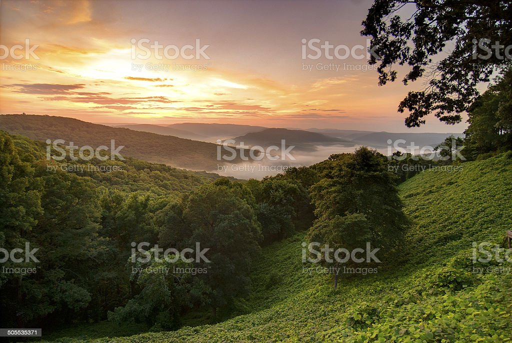 View of a foggy sunrise in the Ozark Mountains stock photo
