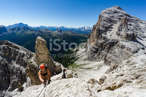 istock view of a group of climbers on a steep Via Ferrata with a grandiose view of the Italian Dolomites in Alta Badia behind them 1179356746