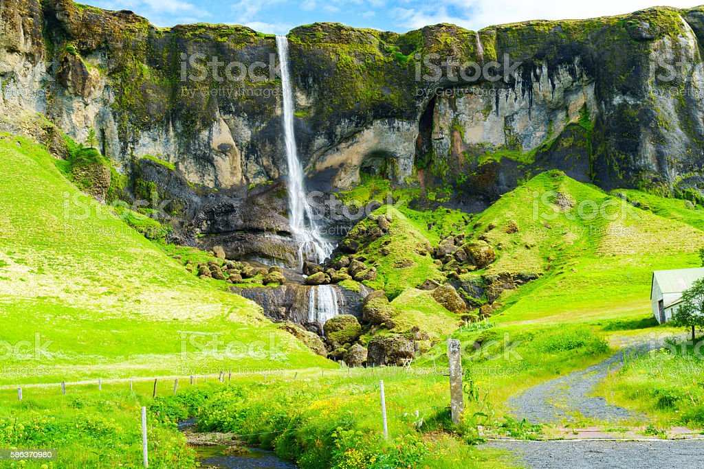 View of a high waterfall in southeast Iceland stock photo