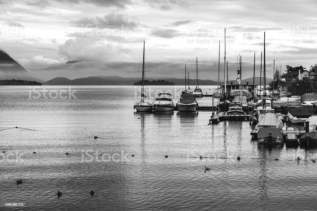 View of a lake marina with stormy clouds. BW image stock photo