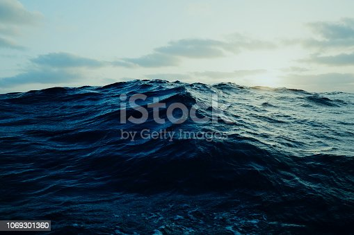 istock view of a large wave far out at the ocean from a sailboat 1069301360