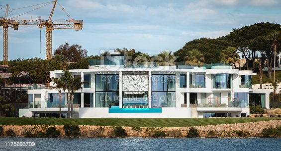 Quinta do Lago, Portugal - May 2, 2018: view of a luxury villa around the lake of Quinta do Lago on a spring day