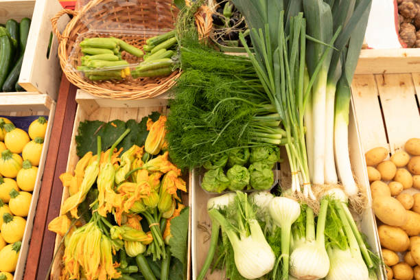 view of a market stall with vegetables