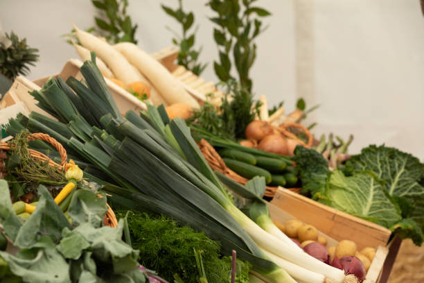 view of a market stall with vegetables stock photo