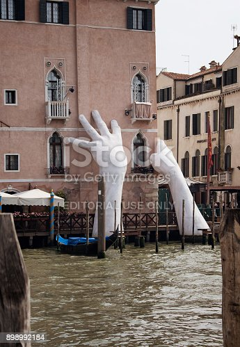 View of a monumental installation sculpture (called support) by Italian artist Lorenzo Quinn for the 2017 Venice Art Biennale to raise awareness about global warming in Venice.