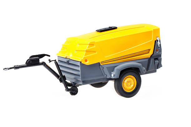 View of a movable air compressor under the white background stock photo