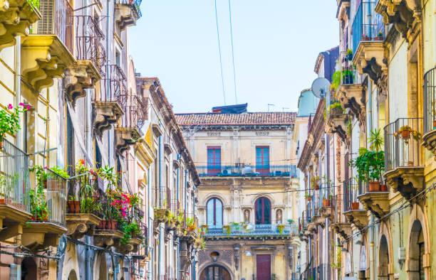 View of a narrow street in Catania, Sicily, Italy View of a narrow street in Catania, Sicily, Italy catania stock pictures, royalty-free photos & images